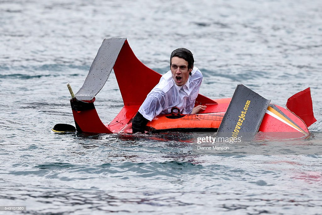 A competitor swims to safety after diving off the wharf during the American Express Queenstown Winter Festival Hits 90.4 Birdman competition on June 26, 2016 in Queenstown, New Zealand.