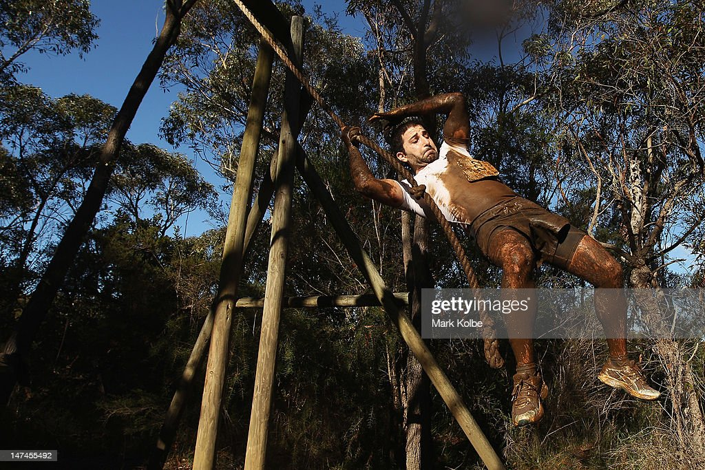 A competitor swings on a rope at the 'Donkey Kong' obstacle as he competes in the Tough Bloke Challenge at the Cataract Scout Park on June 30, 2012 in Sydney, Australia.