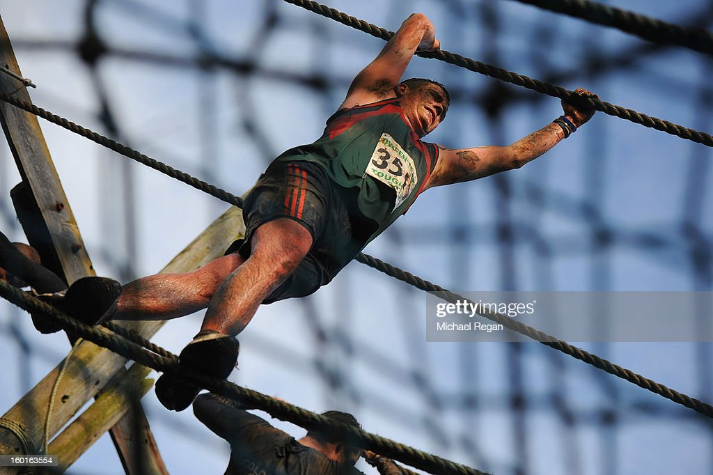 A competitor tackles the rope bridge during the Tough Guy Challenge endurance race on January 27, 2013 in Telford, England. Every year thousands of people run the 8 mile assault course which involves freezing temperatures, fire and ice.