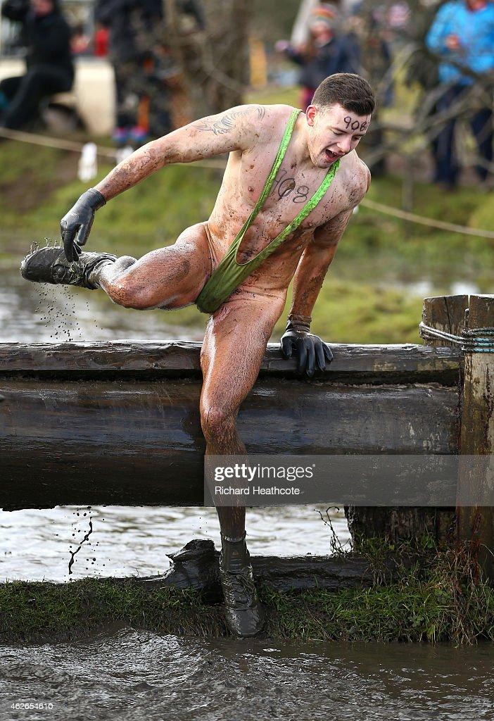 A competitor takes part in a mankini during the Tough Guy Challenge at South Perton Farm on February 1, 2015 in Wolverhampton, England.