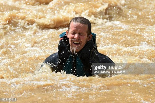 A competitor takes part in Rat Race Dirty Weekend at Burghley House in Lincolnshire