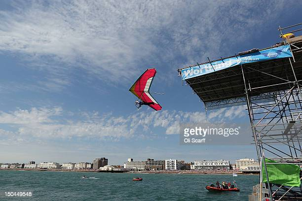 A competitor takes part in the annual International Worthing Birdman contest from Worthing Pier on August 18 2012 in Worthing England The competition...