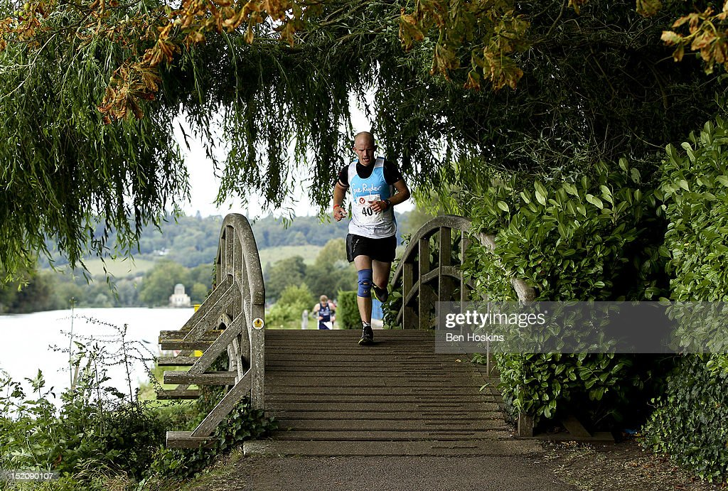 A competitor takes part in the running leg during the Challenge Henley-on-Thames Triathlon on September 16, 2012 in London, England.
