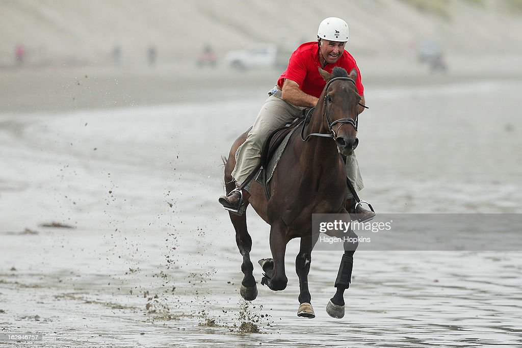 A competitor takes part in the Stewards Handicap during the Castlepoint Beach Races at Castlepoint Beach on March 2, 2013 in Masterton, New Zealand.