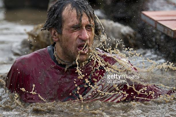A competitor takes part in 'Tough Guy' adventure race near Wolverhampton Staffordshire West Midlands on February 1 2015 The event challenges...