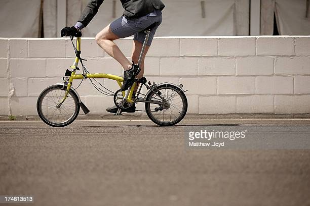 A competitor takes part on a yellow bike in the Brompton World Championship folding bike race which is part of the Orbital cycling festival at...