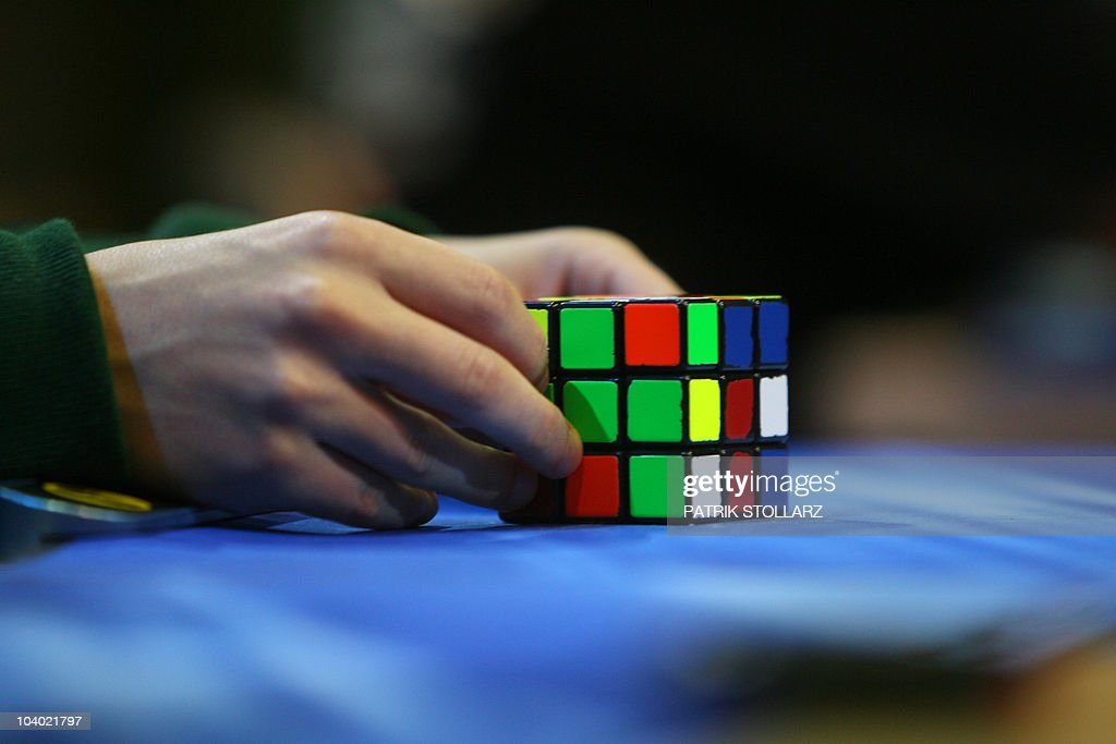 A competitor tries to solve the Rubik cube on the final day of the 2010 Rubik's Cube German Championships in the 3x3x3 cube 'Classical category' in the western German city of Bottrop on September 12, 2010.