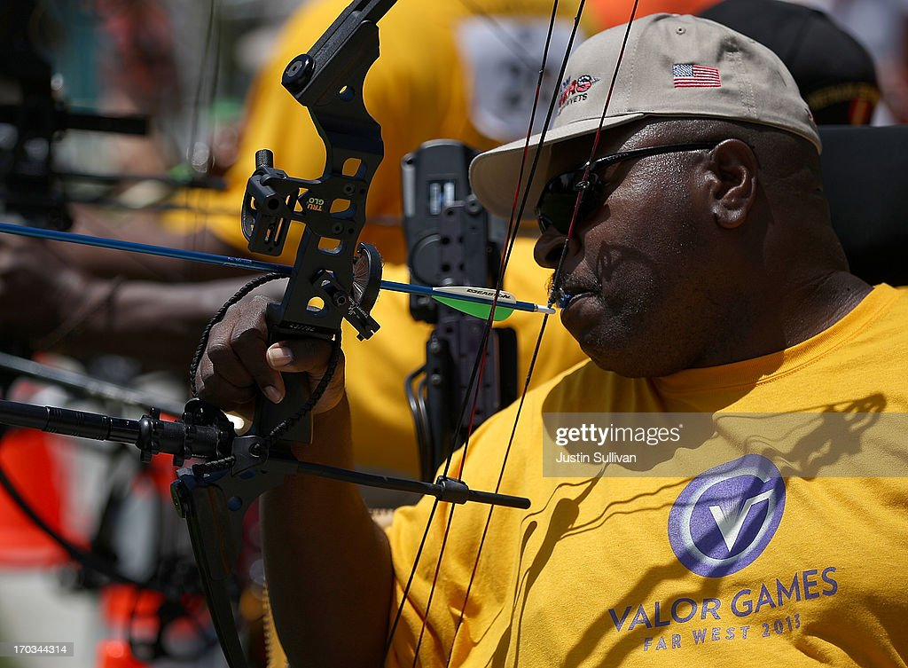 A competitor uses his mouth to pull back a bow and arrow during the archery competition at the inaugural Valor Games Far West on June 11, 2013 in Foster City, California. Dozens of disabled and wounded military veterans are participating in the inaugural 3-day Valor Games Far West that is open to any veteran with a disability who is eligible for VA healthcare. The event is intended to introduce adapted sports to attendees.