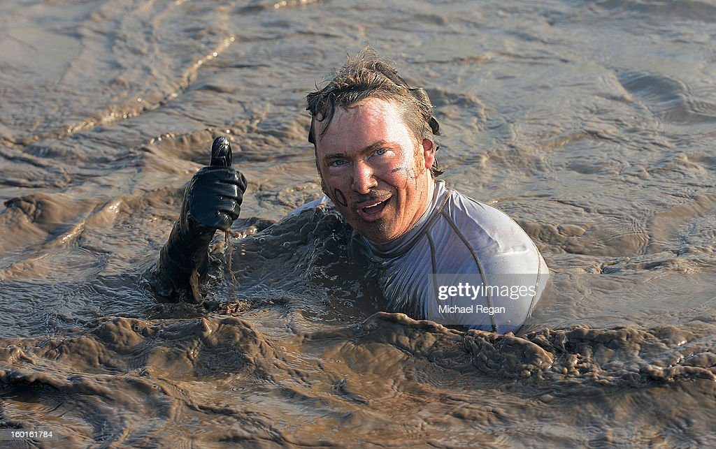 A competitor wades through muddy water during the Tough Guy Challenge endurance race on January 27, 2013 in Telford, England. Every year thousands of people run the 8 mile assault course which involves freezing temperatures, fire and ice.