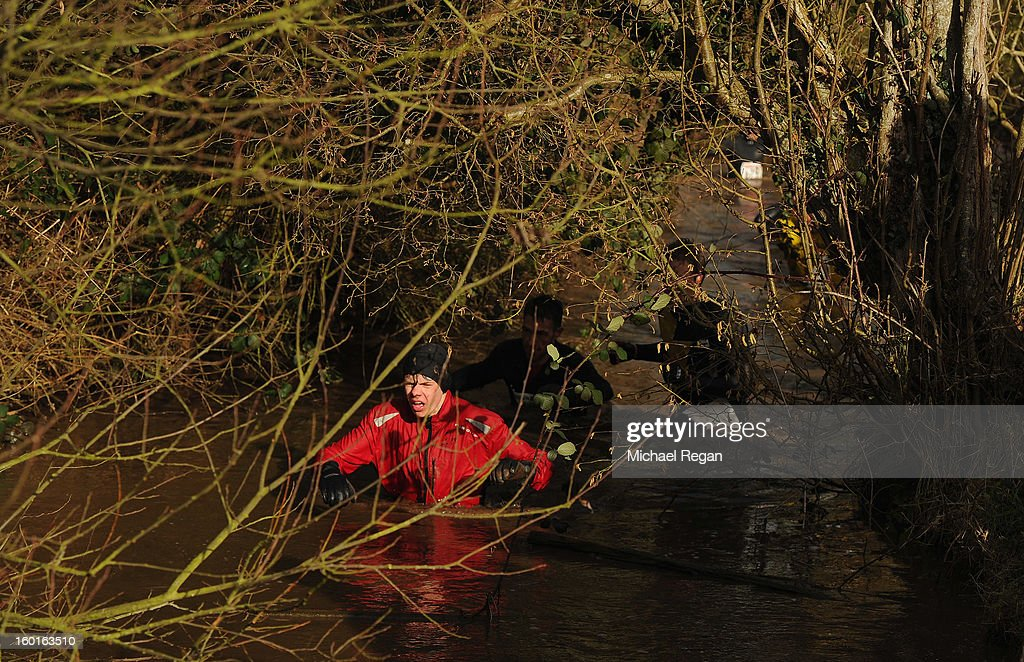A competitor wades through water during the Tough Guy Challenge endurance race on January 27, 2013 in Telford, England. Every year thousands of people run the 8 mile assault course which involves freezing temperatures, fire and ice.