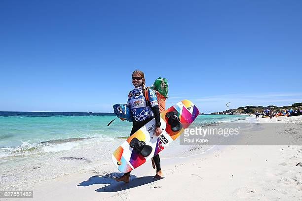 A competitor walks along the beach at Rottnest Island before the start of the Red Bull Lighthouse to Leighton kiteboard race on December 4 2016 in...