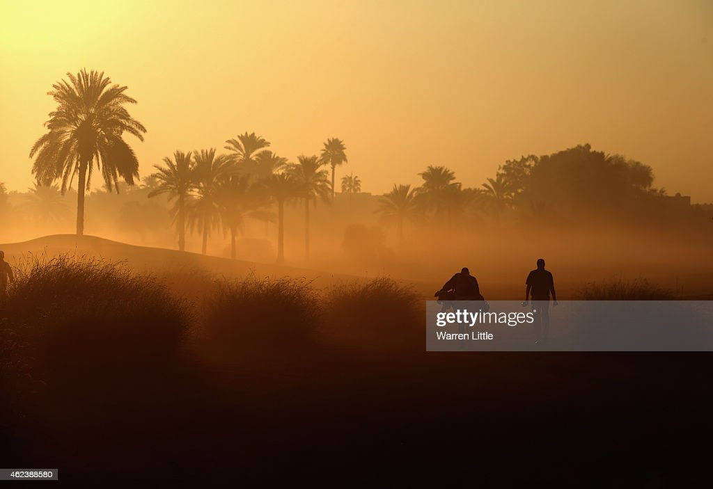 A competitor walks up the 10th hole with his caddie during the proam ahead of the Omega Dubai Desert Classic on the Majlis Course at the Emirates...