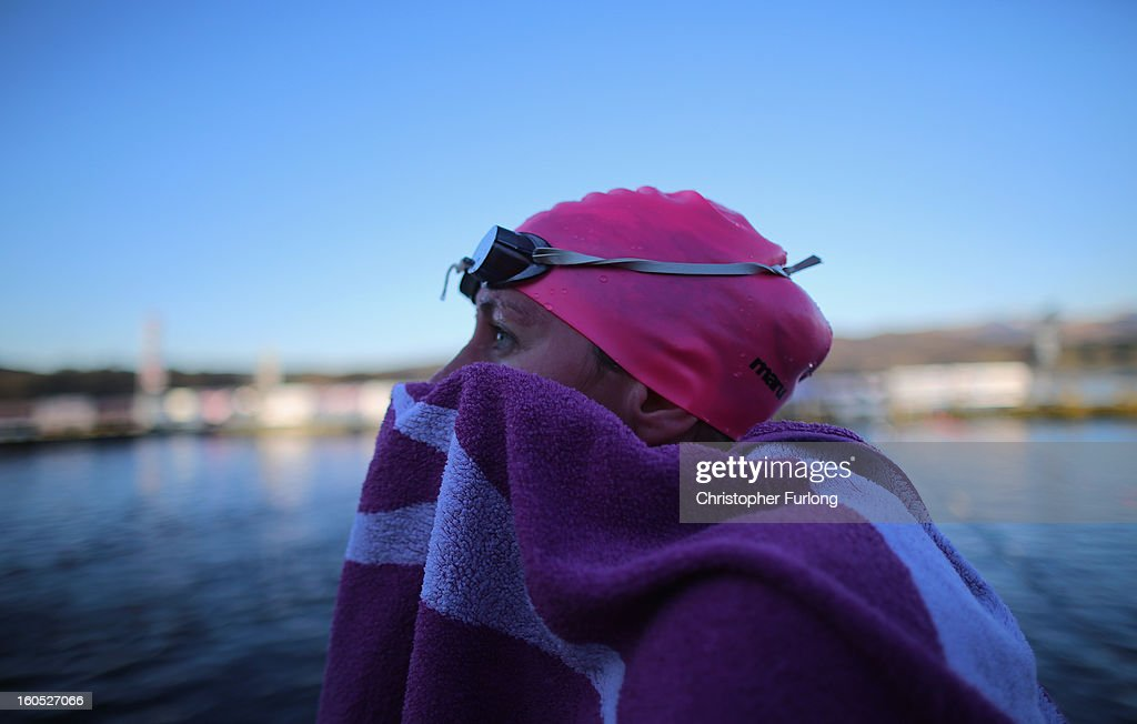 A competitor warms up after braving the chilly waters of Lake Windermere during The Big Chill open swimming event on February 2, 2013 in Windermere, England. The Big Chill swimmers plunged into Lake Windermere, where the water temperature was an average of four degrees celsius, for a series of events including relays, endurance and fun swims.