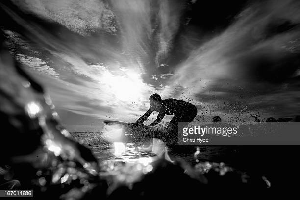 A competitor warms up on the board prior to the start of day three of the 2013 Australian National Surf Lifesaving Titles on April 19 2013 in Gold...