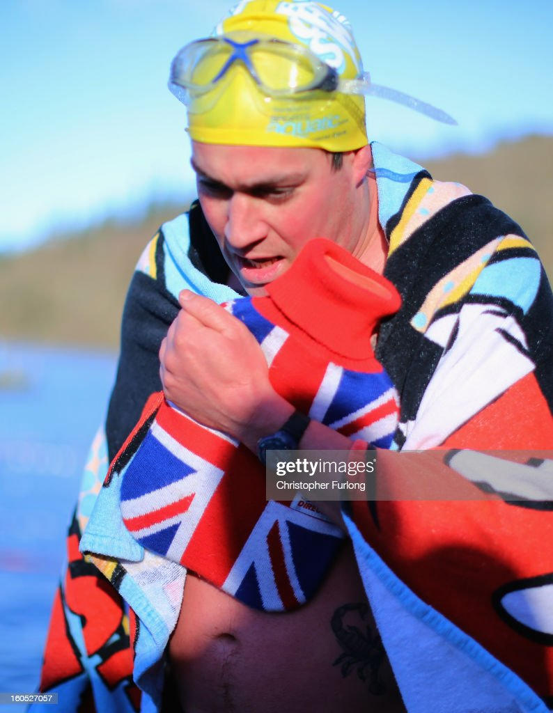 A competitor warms up with a hot water bottle after braving the chilly waters of Lake Windermere during The Big Chill open swimming event on February 2, 2013 in Windermere, England. The Big Chill swimmers plunged into Lake Windermere, where the water temperature was an average of four degrees celsius, for a series of events including relays, endurance and fun swims.