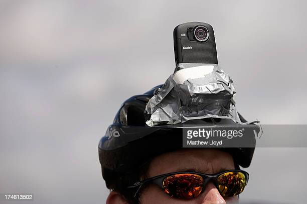 A competitor wears a camera on his hat as he listens to a safety briefing before the Brompton World Championship folding bike race which is part of...