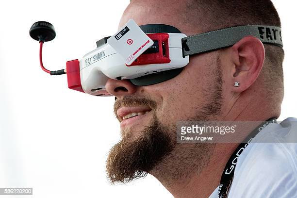 A competitor wears goggles that give him a cockpit camera view of his drone during practice day at the National Drone Racing Championships on...