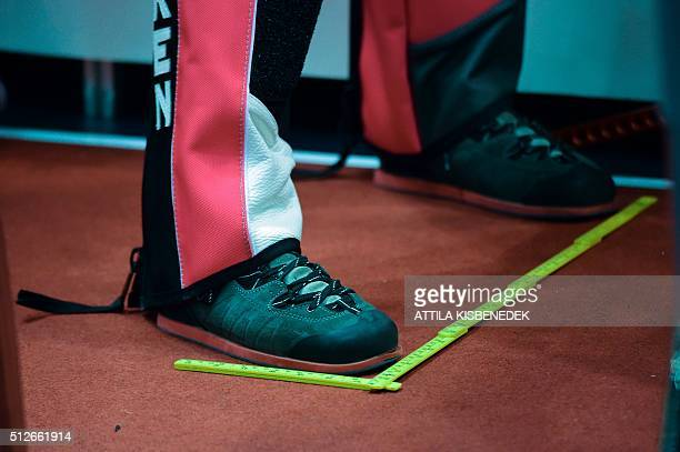 A competitor wears special shooting shoes in AUDI Arena of Gyor on February 26 2016 during the qualification round of 10m air rifle category for...