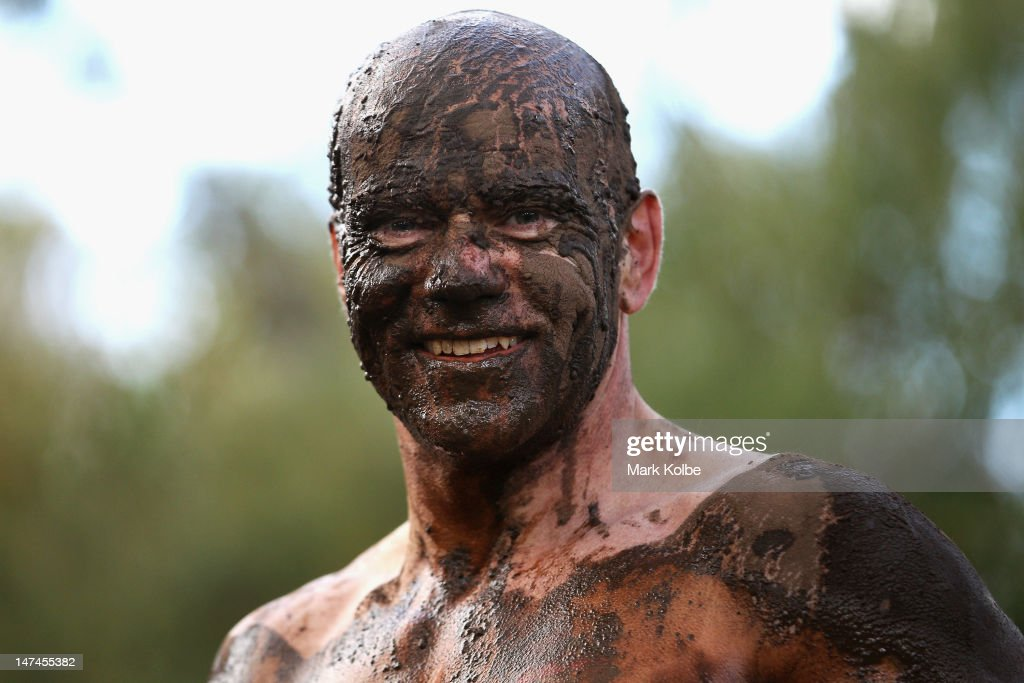 A competitor with mud covering his face poses as he competes in the Tough Bloke Challenge at the Cataract Scout Park on June 30, 2012 in Sydney, Australia.
