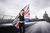 . competitor with Union Jack in front of St Paul's Cathedral in London