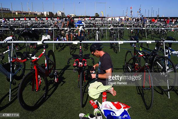 A competitor work on his bike ahead of the Ironman 703 race on May 16 2015 in Barcelona Spain