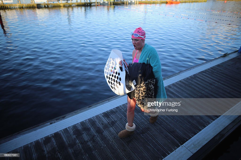 A competitor wraps up after braving the chilly waters of Lake Windermere during The Big Chill open swimming event on February 2, 2013 in Windermere, England. The Big Chill swimmers plunged into Lake Windermere, where the water temperature was an average of four degrees celsius, for a series of events including relays, endurance and fun swims.