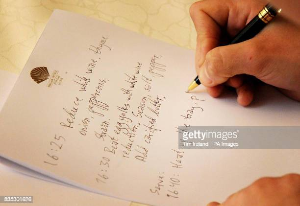 A competitor writes notes during the final of the Roux Scholarship at the Mandarin Oriental Hotel in London