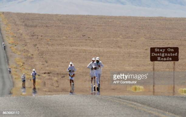 Competitors appear to shimmer as they run on the 145F pavement in the 2008 Badwater Ultramarathon in Death Valley California on July 14 2008 With air...