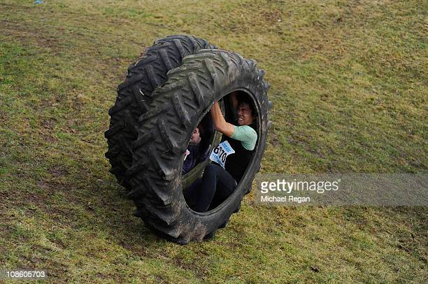Competitors are pushed down a hill in tyres before the Tough Guy race on January 30 2011 in Perton near Wolverhampton England Thousands of...