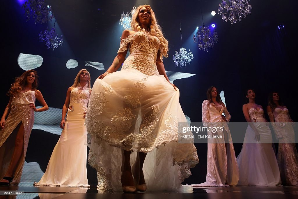 Competitors are seen on stage during Israel's first Miss Trans beauty pageant at Habima national theater in Tel Aviv on May 27, 2016, which marks the beginning of the 2016 Pride events. / AFP / MENAHEM