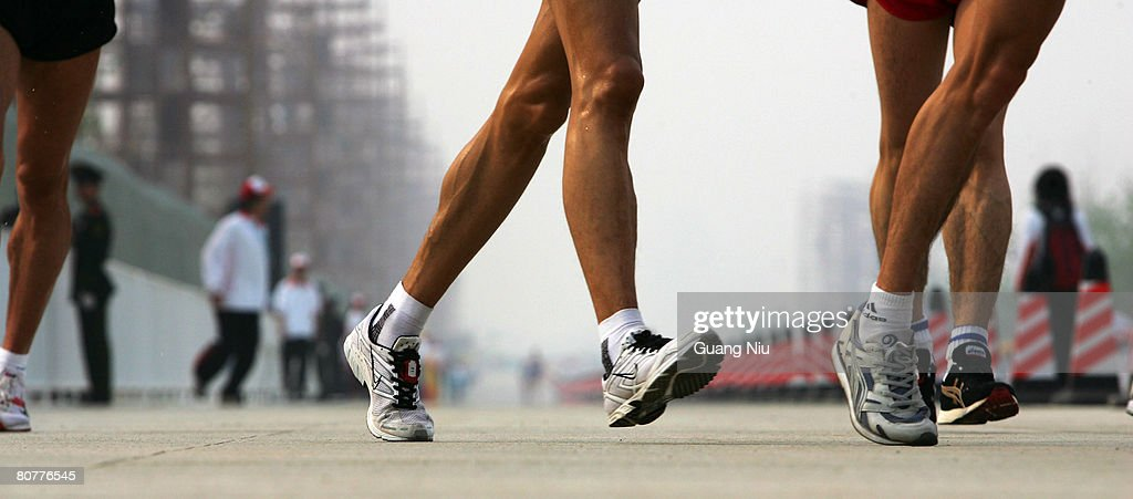 Competitors are shrouded with smog as they take part in the men's 50 km walk race during the 2008 BBMG IAAF Race Walking Challenge around the National Stadium, or the 'Bird's Nest', on April 19, 2008 in Beijing, China.
