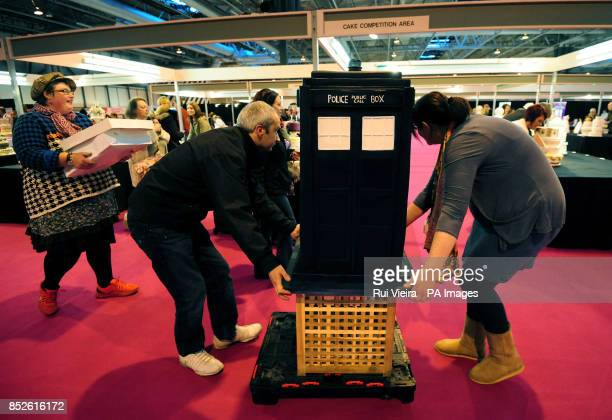 Competitors arrive with a Tardis cake at Cake International NEC Birmingham