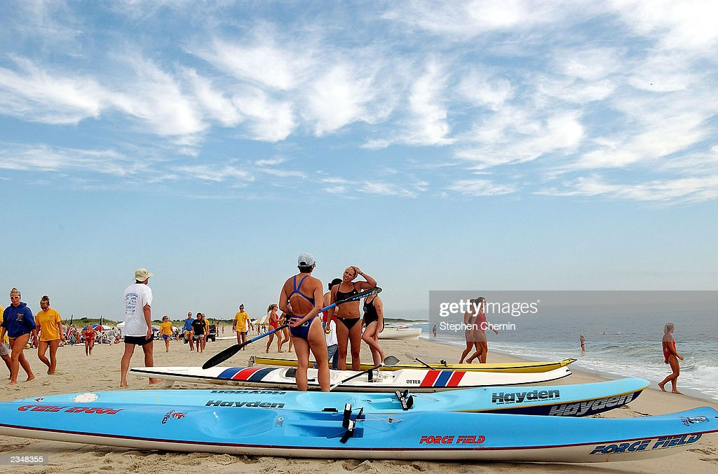 Competitors at the National Park Service AllWomen Lifeguard Tournament ready their surfski tenders July 30 2003 in Sandy Hook New Jersey About two...