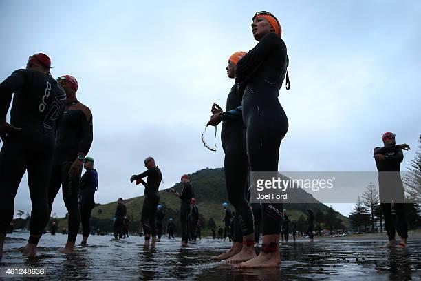 Competitors await the start of the Port of Tauranga Half Ironman on January 10 2015 in Tauranga New Zealand