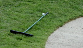 A competitors ball lays up against a rake placed outside of bunker during the third round of the HSBC Women's Champions at the Sentosa Golf Club on...
