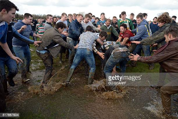 Competitors battle for the 'bottle' in The traditional Easter Monday 'Bottle Kicking Match' which takes place near the village of Hallaton central...