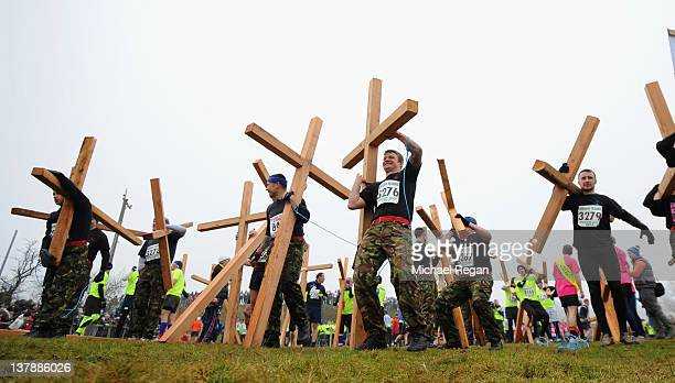 Competitors carry crucifixes as they wait for the start of the Tough Guy Challenge endurance race on January 29 2012 in Telford England Every year...