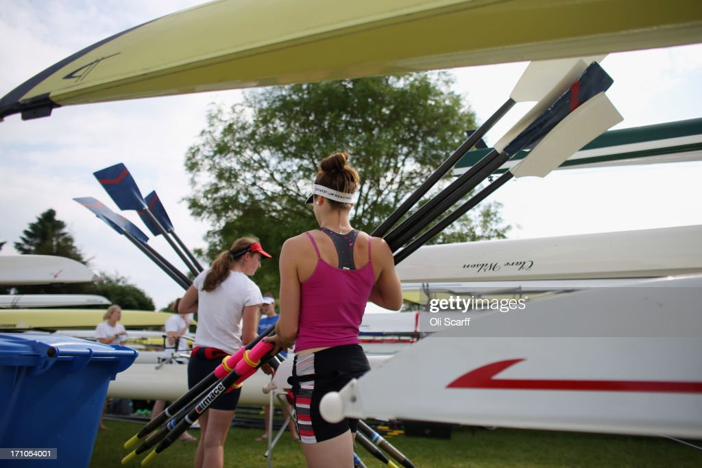 Competitors carry oars at the end of the first day of the Henley Women's Regatta on June 21, 2013 in Henley-on-Thames, England. The annual 3-day event, which has taken place since 1988, sees female crews from the UK and abroad compete on the Henley Royal Regatta course. In the past, several female rowers who have enjoyed success at the Henley Women's Regatta have gone on to win Olympic medals in the sport.