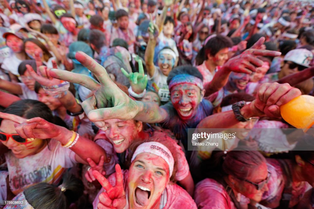 Competitors celebrate completing the Colour Run at the Beijing International Garden Expo park on August 10, 2013 in Beijing, China. It's the first time China hosts this event.