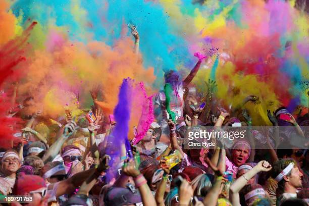 Competitors celebrate completing the Colour Run on June 2 2013 in Gold Coast Australia