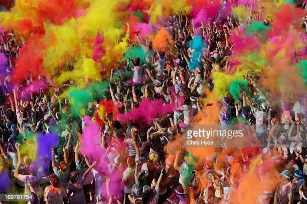 Competitors celebrate completing the Colour Run on June 2 2013 in Gold Coast Australia