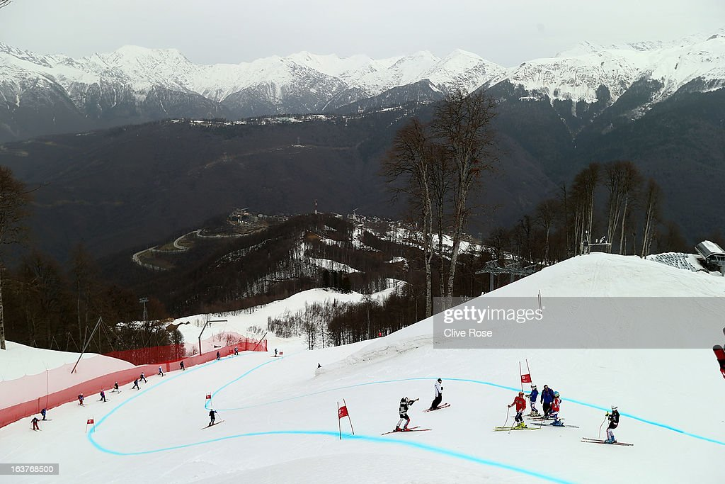 Competitors check the course condition prior to the women's Downhill Training at Rosa Khutor Alpine Center on March 15, 2013 in Sochi, Russia.
