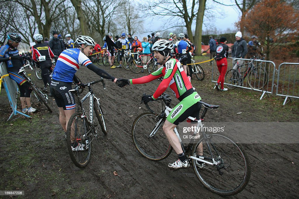 Competitors congratulate each other following the 'Veteran 40-49 Men' category race at the 2013 National Cyclo-Cross Championships in Peel Park on January 12, 2013 in Bradford, England. The sport of cyclo-cross, featuring lightweight bikes with off-road tyres, has dramatically increased in popularity over the past few years. Cyclo-cross courses are often run over a mixture of terrains from tarmac to mud and frequently include obstacles or steep inclines where riders have to carry their bike.