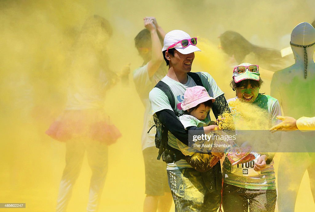 competitors covered in colored powder during the 'Color Me Rad' on April 19, 2014 in Chiba, Japan.