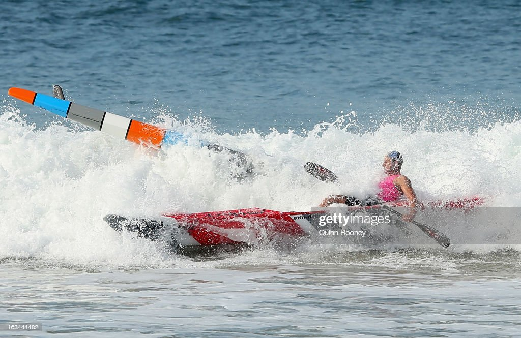 Competitors crash into each other in the Men's ski race during the Victorian Surf Lifesaving Championships on March 10, 2013 in Anglesea, Australia.
