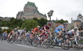 Competitors cycle beneath the Chateau Frontenac during the Grand Prix du Quebec on September 10 2010 in Quebec Canada AFP PHOTO / ROGERIO BARBOSA
