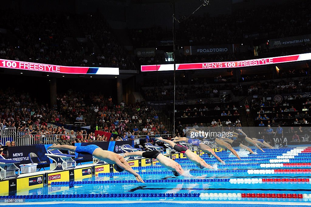 Competitors dive into the pool during a preliminary heat of the Men's 100 Meter Freestyle as they start their race during Day 4 of the 2016 U.S. Olympic Team Swimming Trials at CenturyLink Center on June 29, 2016 in Omaha, Nebraska.