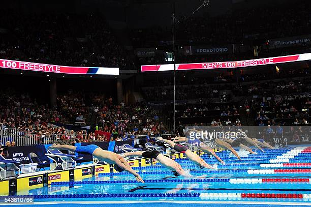 Competitors dive into the pool during a preliminary heat of the Men's 100 Meter Freestyle as they start their race during Day 4 of the 2016 US...
