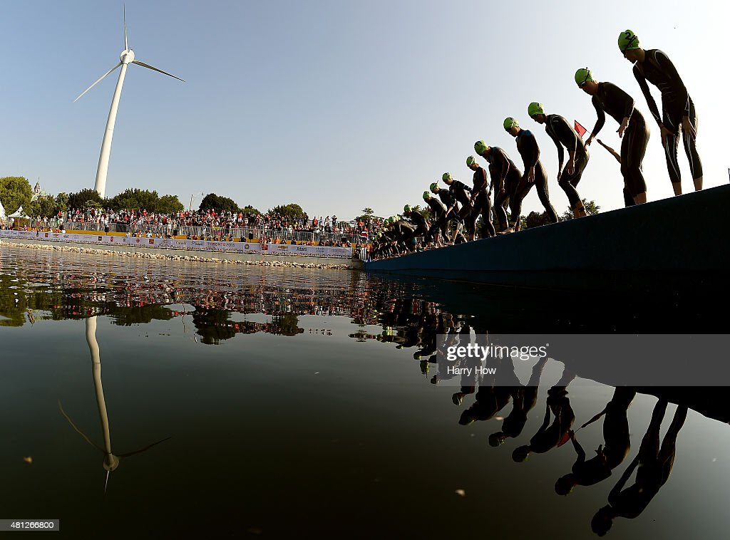 Competitors dive into the water at the start of the women's triathlon at Ontario Place during the during the 2015 Pan American Games for the 2015 Pan American Games on July 11, 2015 in Toronto, Canada.