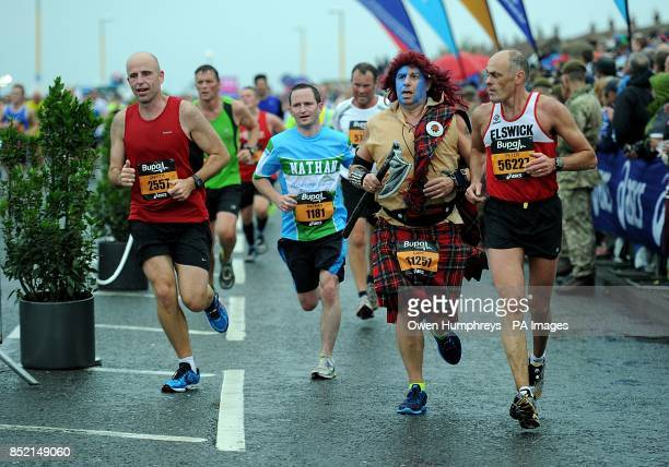 Competitors during the 2013 Great North Run between Newcastle and South Sheilds